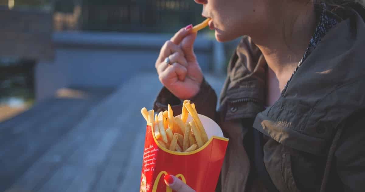 https://www.pexels.com/photo/woman-in-brown-classic-trench-coat-eating-mcdo-fries-during-daytime-139681/