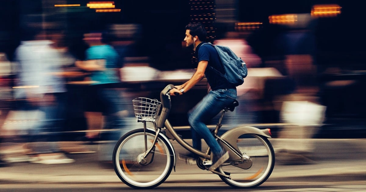 https://www.pexels.com/photo/man-riding-bicycle-on-city-street-310983/
